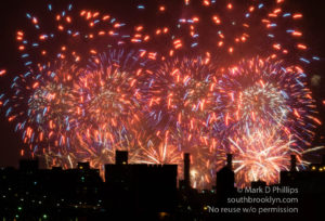 Macy's Fourth of July Fireworks fill the sky with fire above the city.
