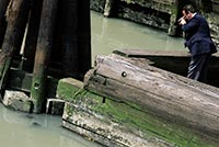 NYPD Detective photographs body in the Gowanus Canal, Copyright Mark D Phillips
